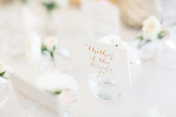 Escort Cards in Bud Vases