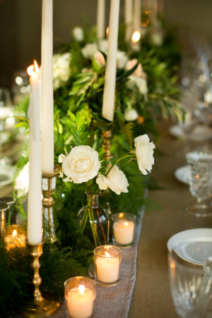 Centerpiece of Candles and Greenery