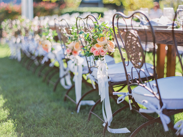 Flowers on Wrought Iron Chairs at Wedding