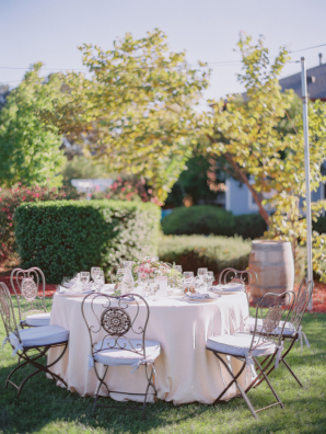 Garden Wedding with Decorative Wrought Iron Chairs