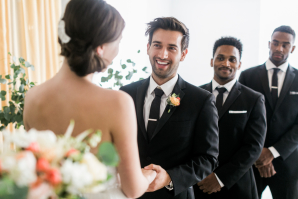 Groom with Tie Clip and Coral Boutonniere
