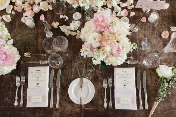 Pink and Ivory Flowers on Wooden Table