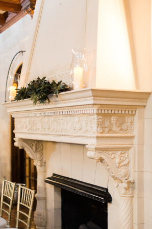 Greenery and Candles on Wedding Mantel
