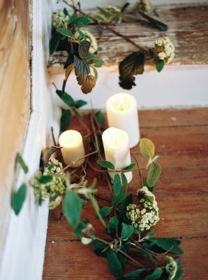 Pillar Candles and Greenery on Staircase
