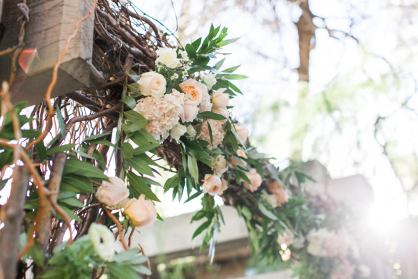 Rustic Ceremony Arbor with Pink Flowers