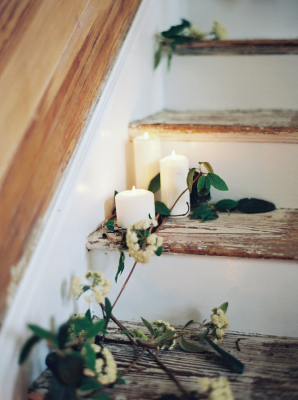 White Pillar Candles on Stairs