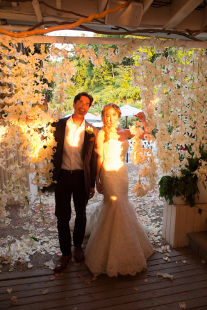 Bride and Groom with Hanging Orchids