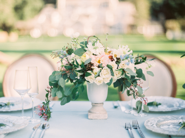 Green and White Centerpiece on Blue Table