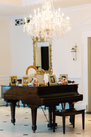 Piano with Framed Family Photos