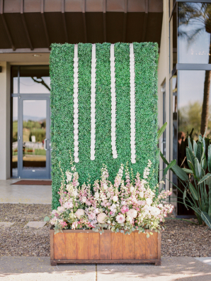 Escort Cards on Faux Greenery Wall