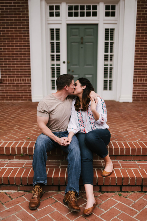 Husband and Wife on Steps of New Home