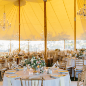 Tent Wedding Reception with Yellow Lighting