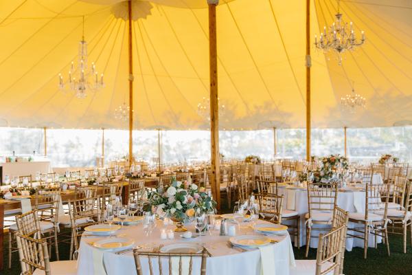 Tent Wedding Reception with Yellow Lighting