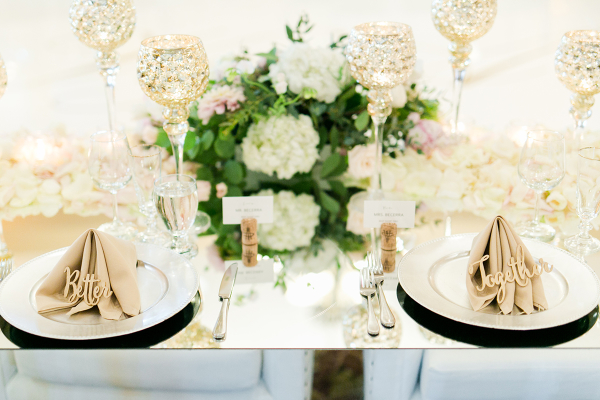 Ivory and Green Centerpiece on Mirror Table