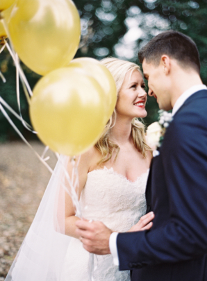 Bride and Groom with Gold Balloons