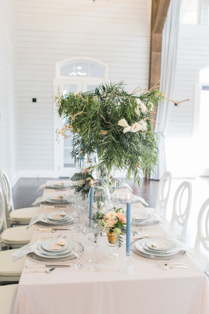 Centerpiece with Tall Greenery and Taper Candles