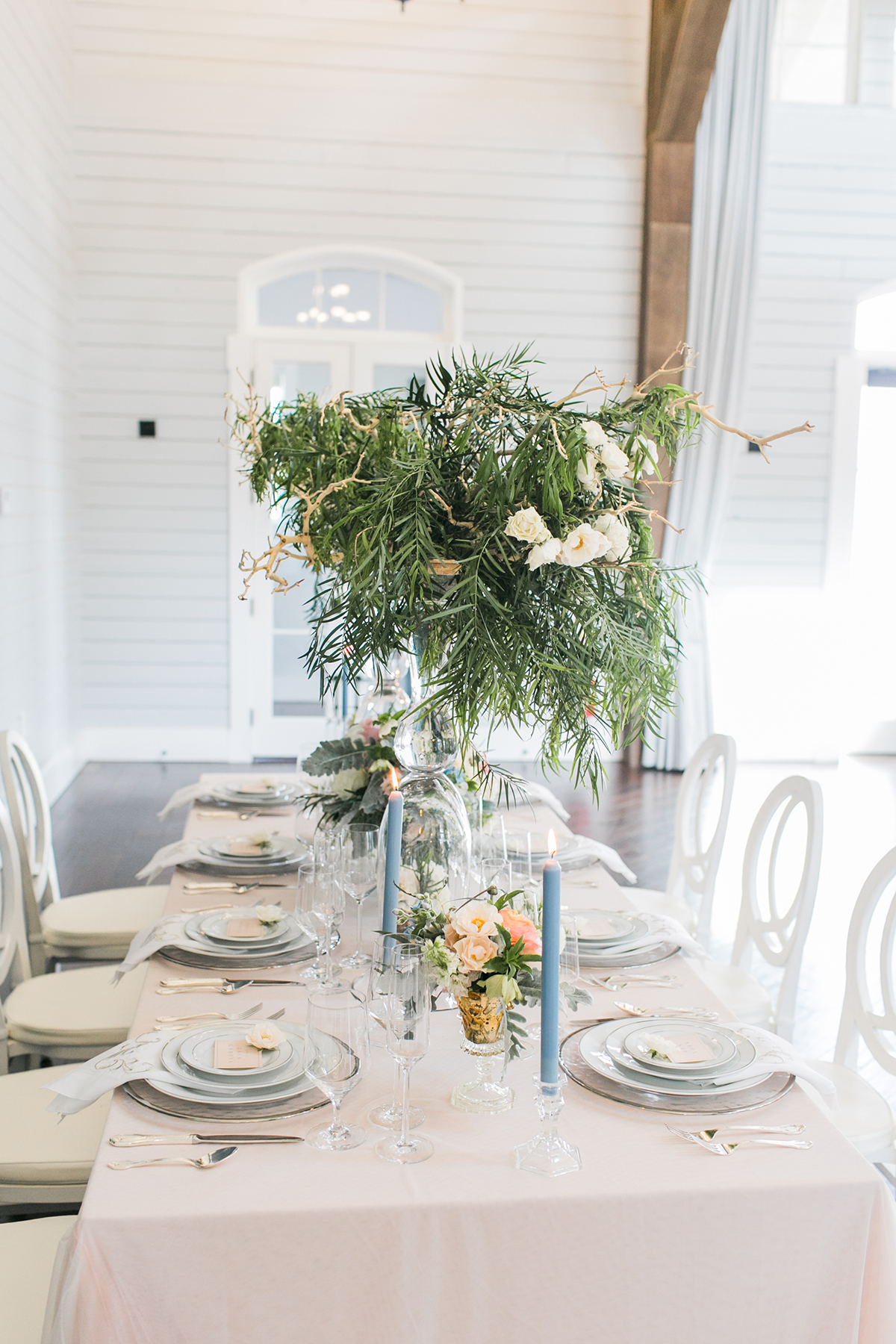 Centerpiece with Tall Greenery and Taper Candles - Elizabeth Anne ...