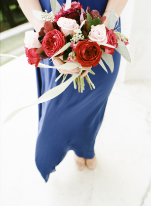 Blue Bridesmaid Dress with Red Bouquet