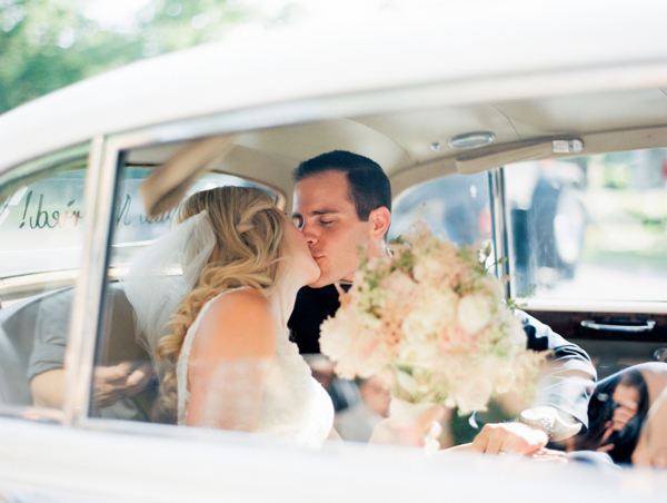 Bride and Groom in Vintage Car