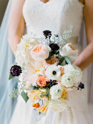 Bride with Apricot and Burgundy Bouquet