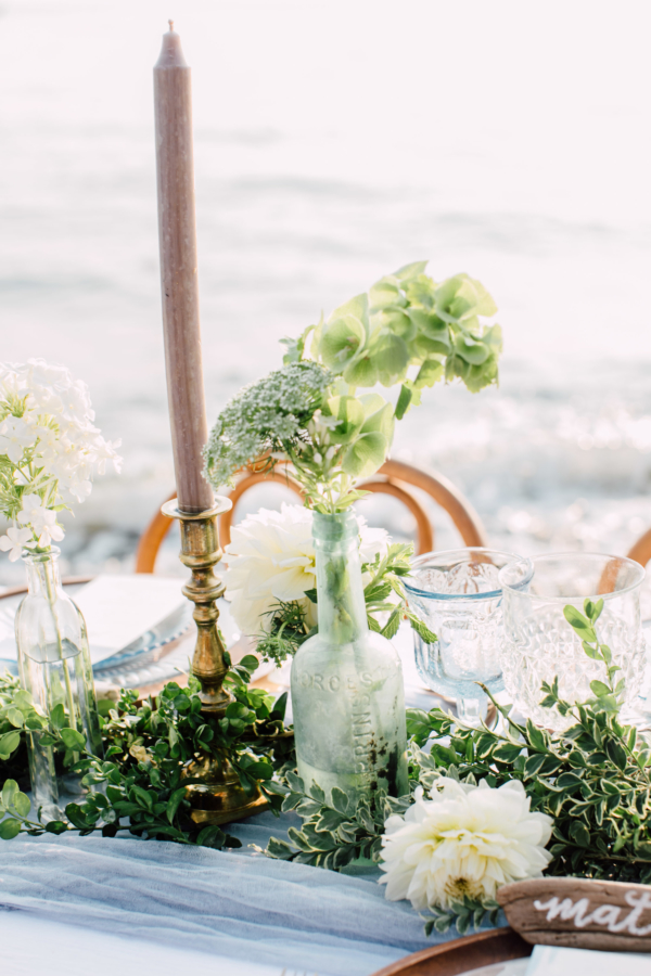 Mixed Bottles and Taper Candle Centerpiece