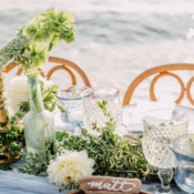 Mixed Glass and Greenery Centerpiece