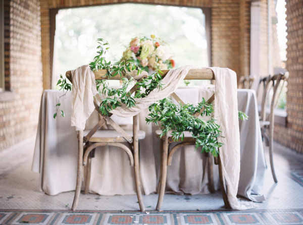 Greenery and Silk Draping on Wedding Chairs