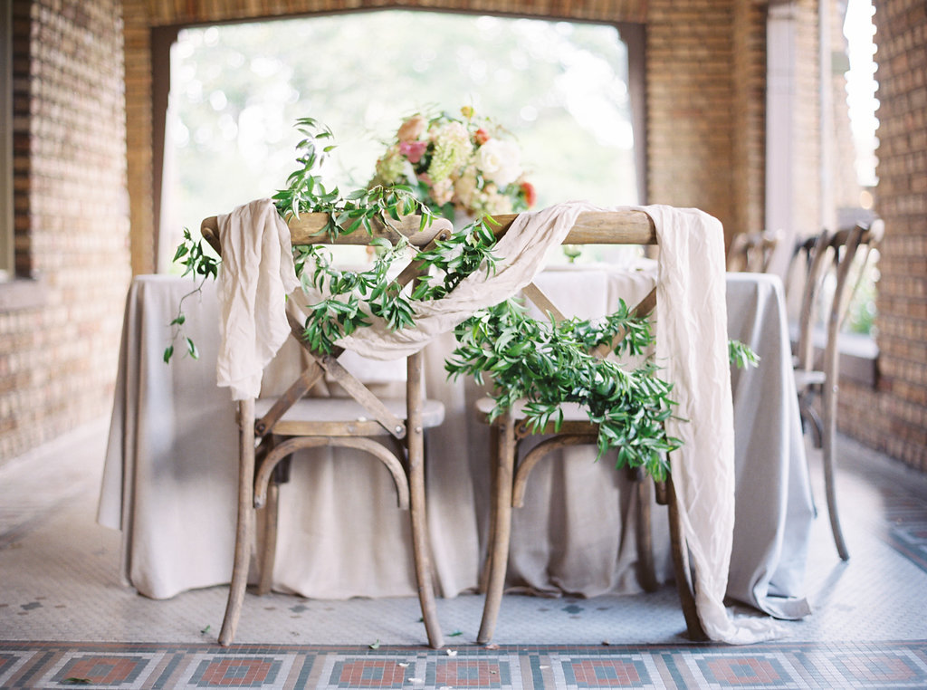 Greenery and Silk Draping on Wedding Chairs