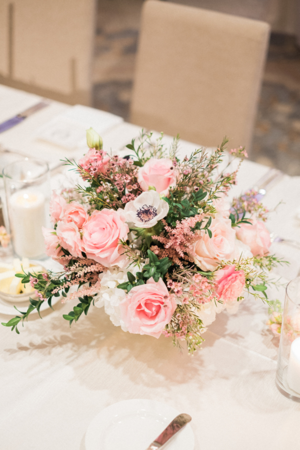 Centerpiece of Pink and White Roses and Anemones