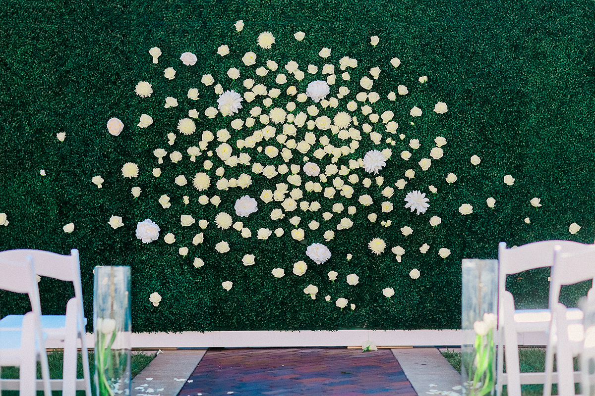 flower and grass wall ceremony backdrop elizabeth anne designs