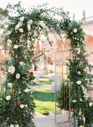 Wedding Arbor with Greenery and White Flowers