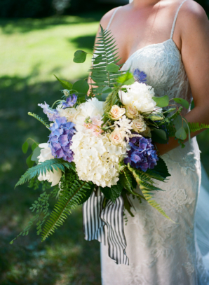 Bride with White and Purple Bouquet and Striped Ribbon