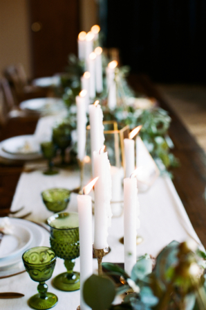 Taper Candles and Green Glassware
