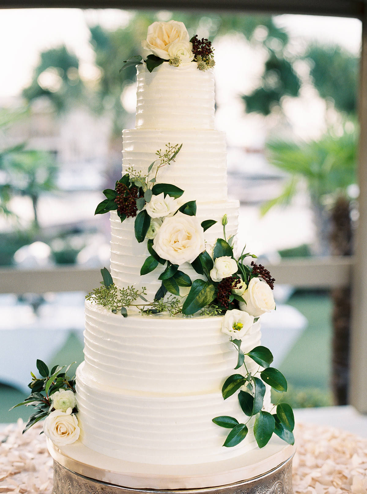 Wedding Cake With Cascading Flowers And Greenery