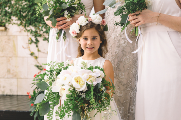 Adoralbe Flower Girl Holding Bouquet