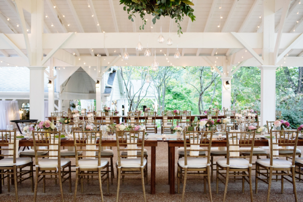 Wooden Wedding Tables Under String Lights