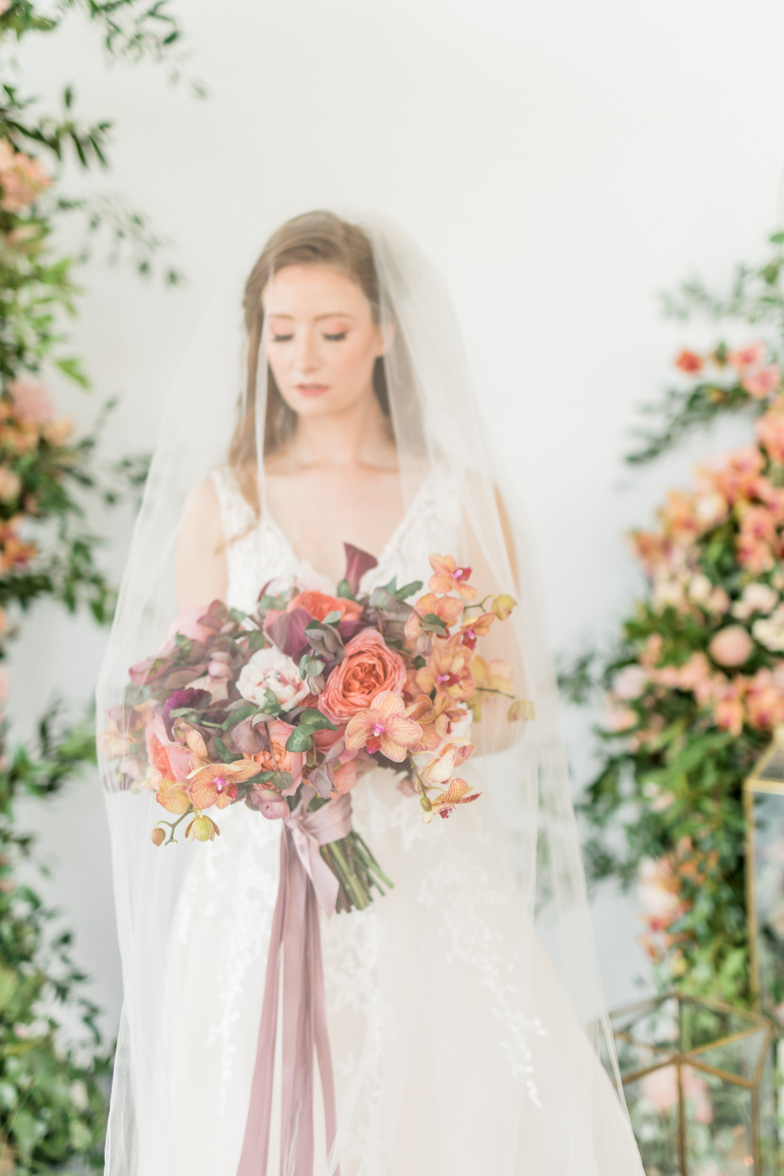 Bride with Coral and Mauve Bouquet
