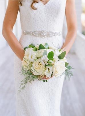 Bride with Ivory Garden Rose Clutch