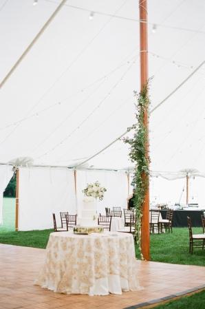 Dance Floor with Wedding Cake Under Tent