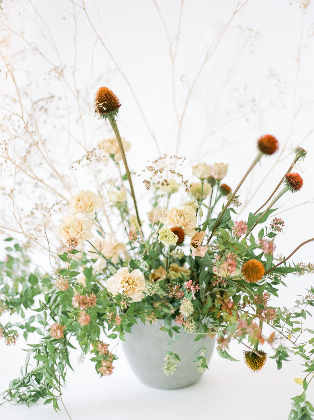 Ivory and Rust Carnation and Coneflower Wedding Ceremony Flowers