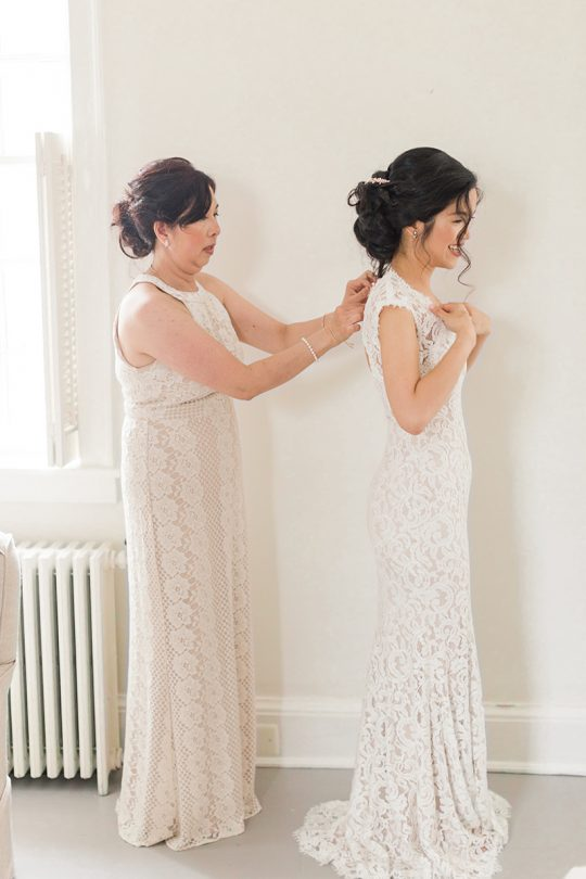 Bride and Mother Getting Ready Wedding Photo