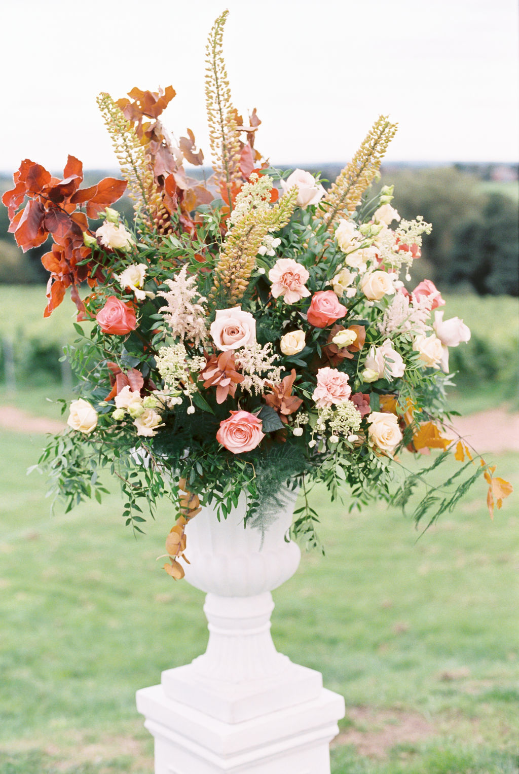 Tall Fall Inspired Wedding Ceremony Floral Arrangement